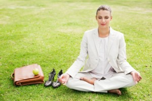 woman-meditating-in-park